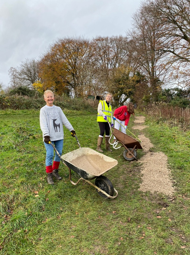 Volunteers laying gravel